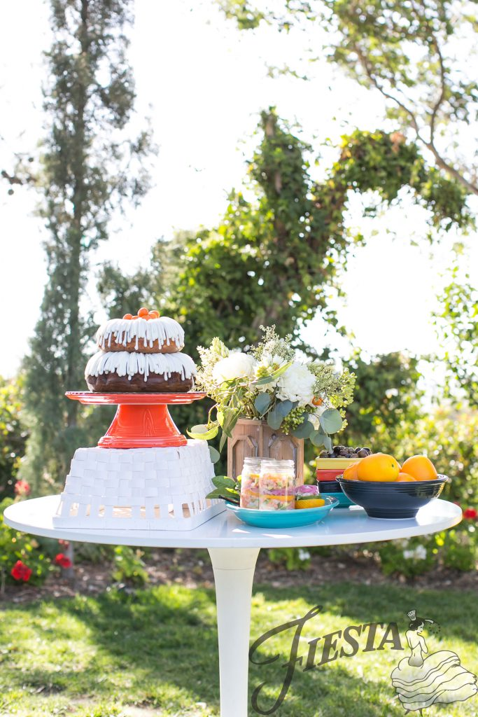 Fiesta Dinnerware cake stand hack: Hostess Bowl turned upside down with Pizza/Baking Tray on top. Genius!