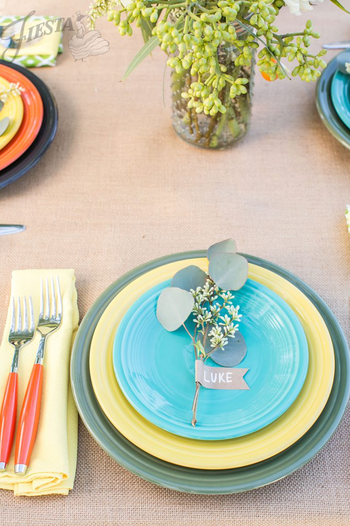 A natural place card stands out against colorful Fiesta Dinnerware at this outdoor summer wedding. Fiesta Napkin, Flatware and Dishes in colors: Sunflower, Poppy, Sage, Slate, and Turquoise.