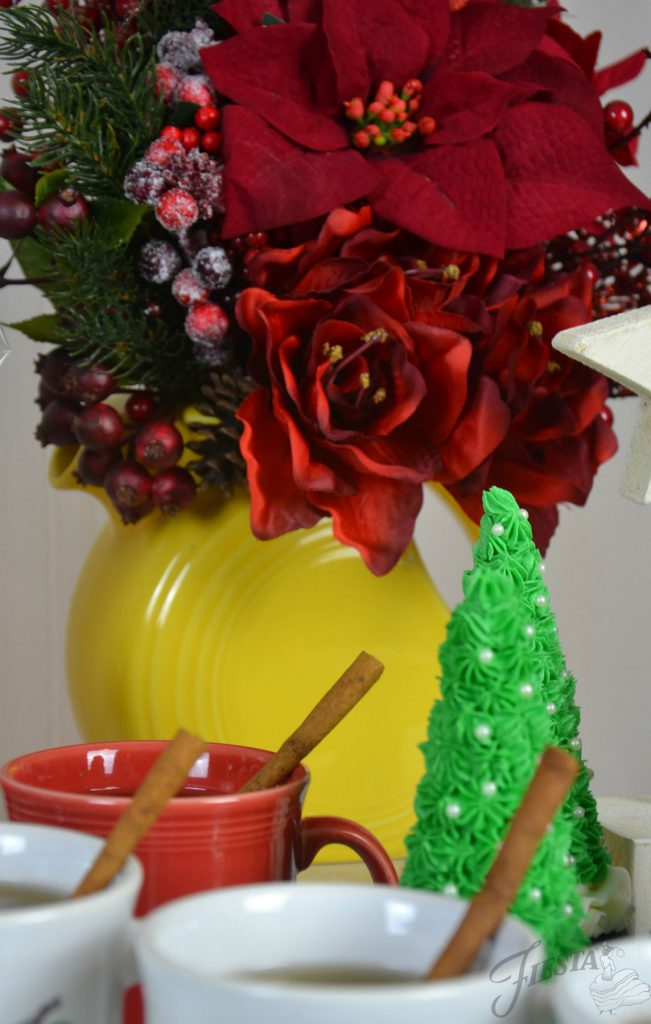 A holiday arrangement of Poinsettias in a Sunflower Vase